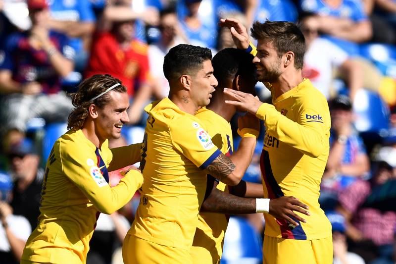 Barcelona's players celebrating a goal against Getafe / OSCAR DEL POZO/GETTY IMAGES